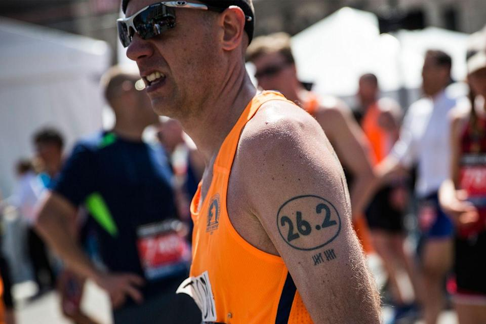 """<p>People get <a href=""""https://www.runnersworld.com/runners-stories/g20951988/47-awesome-running-inspired-tattoos/"""" rel=""""nofollow noopener"""" target=""""_blank"""" data-ylk=""""slk:tattoos"""" class=""""link rapid-noclick-resp"""">tattoos</a> celebrating all kinds of achievements, so why not a half-marathon, marathon, or ultra? Whether it's the classic """"26.2"""" or a running shoe or the outline of a race course, we love a tattoo that says """"I love to run.""""</p>"""