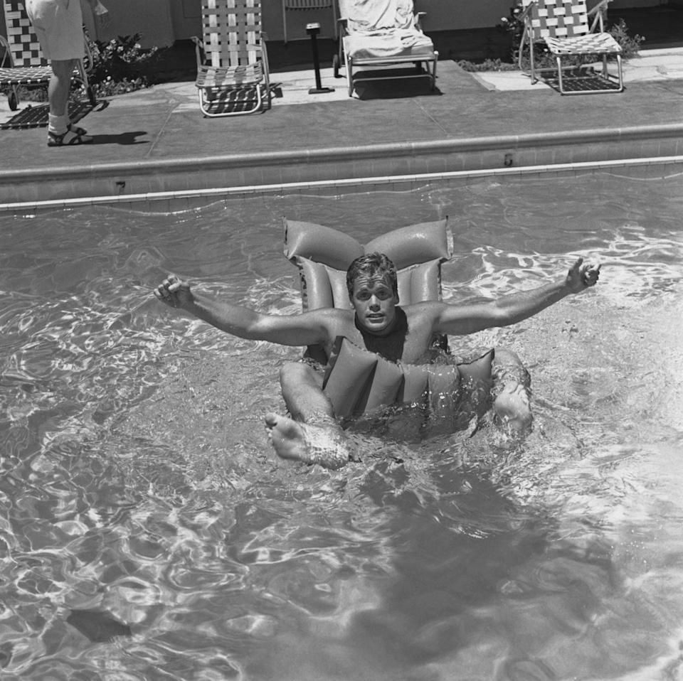 <p>Television actor Doug McClure, best known for his roles in <em>The Twilight Zone</em> and <em>The Virginian</em>, plays around on a pool float under the hot desert sun in June of 1960. </p>