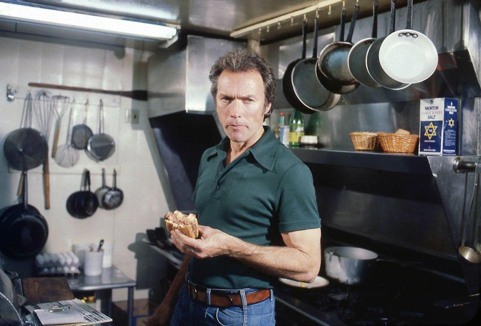 <p>Clint Eastwood eats a sandwich in Pebble Beach, California in 1979.</p>