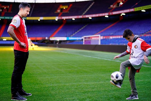 Robin van Persie and his son Shaqueel are pictured on the pitch of De Kuip stadium, after the Dutch player signed a contract with Feyenoord, in Rotterdam, Netherlands January 22, 2018. REUTERS/Cris Toala Olivares