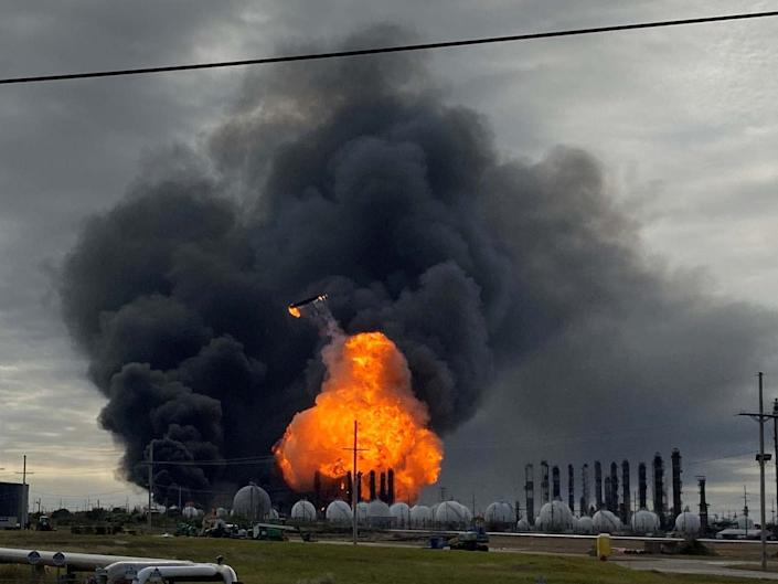 Flames are seen after a massive explosion that sparked a blaze at a Texas petrochemical plant: REUTERS