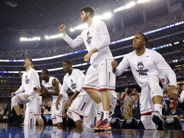Connecticut players celebrate against Kentucky during the second half of the NCAA Final Four tournament college basketball championship game Monday, April 7, 2014, in Arlington, Texas. (AP Photo/Eric Gay)