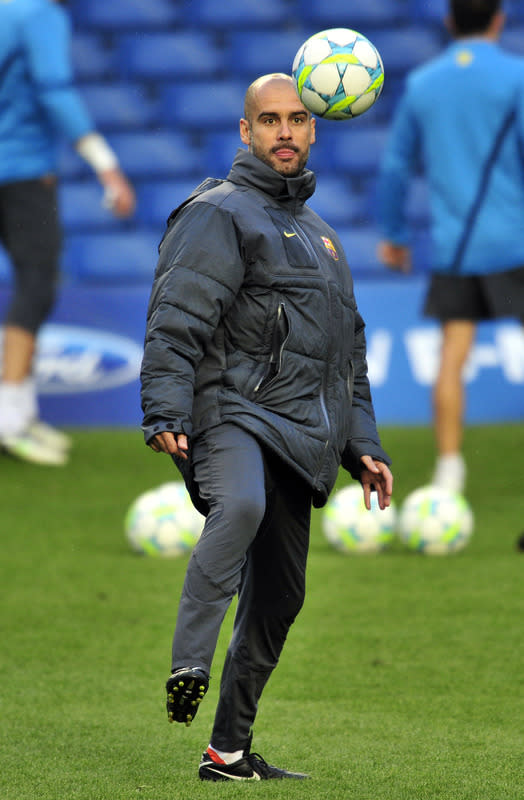 FILES - Picture taken on April 17, 2012 shows Pep Guardiola, then Barcelona's coach, taking part in a training session at Stamford Bridge in London, on the eve of the UEFA Champions League semi-final first leg football match between Barcelona and Chelsea. German giants Bayern Munich are in talks to sign former Barcelona coach Pep Guardiola when current boss Jupp Heynckes steps down in 2013, mass circulation Bild reported on June 19, 2012.   AFP PHOTO/GLYN KIRKGLYN KIRK/AFP/GettyImages