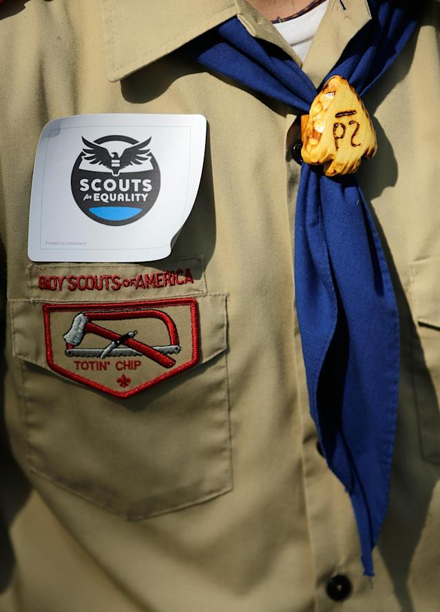 "WASHINGTON, DC - MAY 22: Members of Scouts for Equality hold a rally to call for equality and inclusion for gays in the Boy Scouts of America as part of the ""Scouts for Equality Day of Action"" May 22, 2013 in Washington, DC. The Boy Scouts of America is scheduled to hold a two day meeting tomorrow with 1,400 local adult leaders to consider changing its policy of barring openly gay teens from participating in the Boy Scouts. (Photo by Win McNamee/Getty Images)"