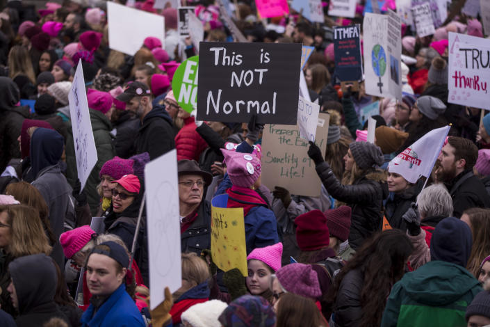 Demonstrators hold signs during the 2019 Women's March on Jan. 19, 2019 in Washington. (Photo: Zach Gibson/Getty Images)