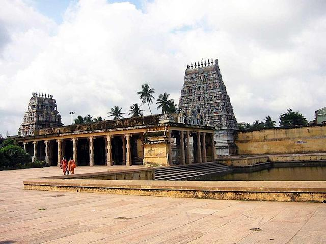 """Temple Tank at Sirgazhi Temple. Sirgazhi temple is one of the most important temples for Saivites as it is the birthplace of the Saiva saint Tirugnanasambandar, the foremost of the Saiva Nayanars, belonging to the 7th century. Thirugnanasambandar, as an infant, is believed to have been fed with the milk of wisdom by the divine mother Parvati on the banks of the temple tank. The child Sambandar started singing the anthology of Thevaram hymns from then on, commencing with """"Todudaiya Seviyan"""". This is one of 275 Padal Petra Sthalams or Thirumurai temples. The temple has three vast courtyards with high walls of enclosure. There are two sets of seven tiered gopurams in the outer walls of the enclosure. The temple is about 25 km from the town of Kumbakonam."""
