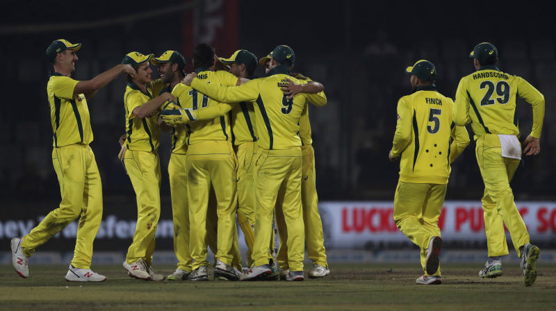 Australia's players celebrate their win in the one day series against India in New Delhi, India, Wednesday, March 13, 2019. (AP Photo/Altaf Qadri)