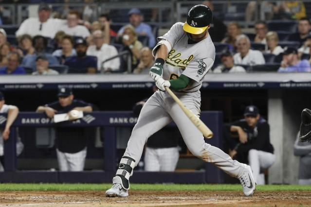 Oakland Athletics' Seth Brown hits an RBI single during the seventh inning of the team's baseball game against the New York Yankees on Friday, Aug. 30, 2019, in New York. (AP Photo/Frank Franklin II)