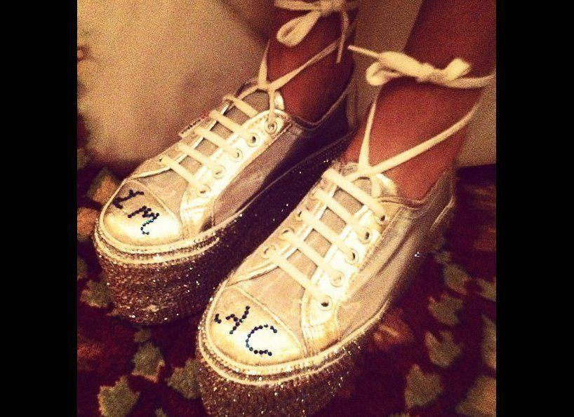 """The """"Man Repeller"""" wore custom-made platform sneakers under her Marchesa wedding dress to her longtime beau. The couple's initials were bedazzled on the sneaks. All together now, """"Awwww.""""    June 2012, New York City    Dannijo/Instagram"""
