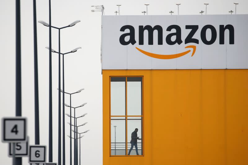 The logo of Amazon is seen at the company logistics center in Lauwin-Planque