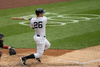 New York Yankees' DJ LeMahieu (26) hits a single during the third inning of a baseball game against the Miami Marlins at Yankee Stadium, Saturday, Sept. 26, 2020, in New York. (AP Photo/Corey Sipkin)