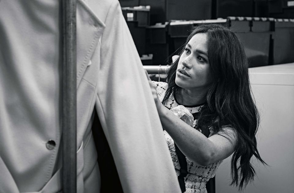 The Duchess of Sussex in the workroom of the Smart Works London office putting together the September issue of British Vogue. [Photo: @SussexRoyal/PA Wire]