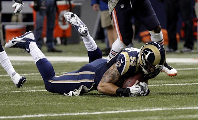 St. Louis Rams linebacker James Laurinaitis recovers a fumble by Chicago Bears running back Matt Forte during the first quarter of an NFL football game on Sunday, Nov. 24, 2013, in St. Louis. (AP Photo/Tom Gannam)