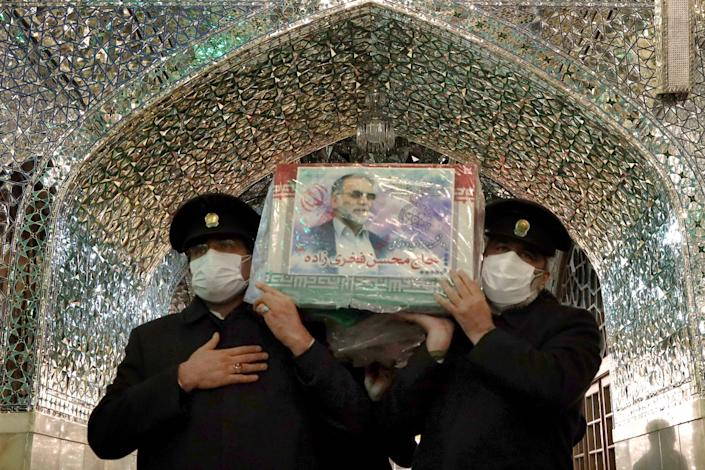 Servants of the Imam Reza Shrine carrying the coffin of Iran's assassinated top nuclear scientist Mohsen FakhrizadehIRANIAN DEFENCE MINISTRY/AFP via