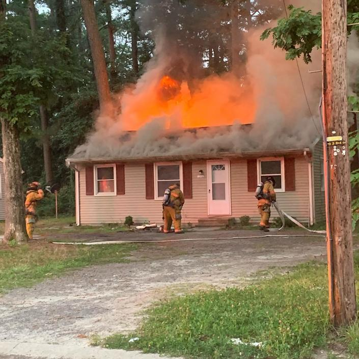 Members of the Salisbury Fire Department and other surrounding crews fight a house fire in Salisbury, Md., on July 21.