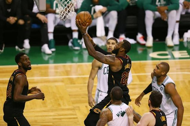 LeBron James of the Cleveland Cavaliers drives to the basket in the second half against the Boston Celtics during the 2018 NBA Eastern Conference Finals in Boston, Massachusetts