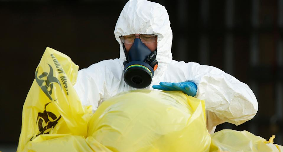 Clinical waste removal personnel at St Basil's Homes for the Aged in Fawkner on Friday. Source: AAP