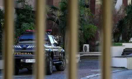 A Federal Police car is seen next to the headquarter of the Brazilian Olympic Committee in Rio de Janeiro, Brazil, September 5, 2017. REUTERS/Sergio Moraes