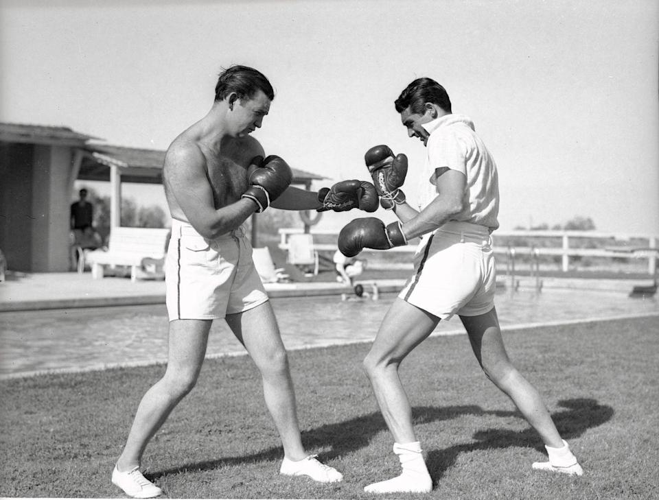 <p>Actor Cary Grant (right), star of Alfred Hitchcock's North by Northwest, learns some boxing moves in preparation for a new film, May 6, 1935.</p>