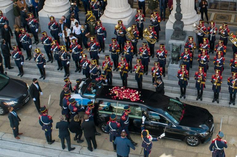 Aerial view of the honour guard carrying the coffin of late former Argentine president (1989-1999) Carlos Menem into a hearse outside the Congress in Buenos Aires before the funeral cortege