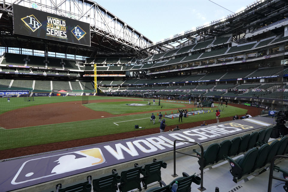 Members of the Tampa Bay Rays warms up during batting practice before Game 1 of the baseball World Series against the Los Angeles Dodgers Tuesday, Oct. 20, 2020, in Arlington, Texas. (AP Photo/Tony Gutierrez)