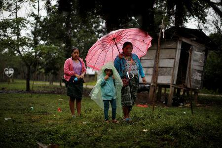 Local residents arrive at a service for Jakelin Caal, a 7-year-old girl who handed herself in to U.S. border agents earlier this month and died after developing a high fever while in the custody of U.S. Customs and Border Protection, at her home village of San Antonio Secortez, in Guatemala December 24, 2018. Picture taken December 24, 2018. REUTERS/Carlos Barria