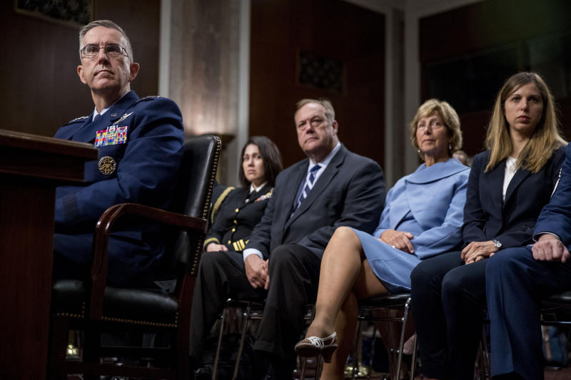 Gen. John Hyten, left, accompanied by members of his family including his wife Laura, second from right, and his daughter Katie, right, appears before the Senate Armed Services Committee on Capitol Hill in Washington, Tuesday, July 30, 2019, for his confirmation hearing to be Vice Chairman of the Joint Chiefs of Staff. (AP Photo/Andrew Harnik)