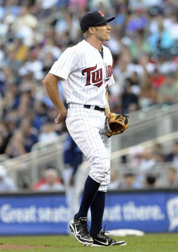 Minnesota Twins pitcher Cole DeVries reacts as he gives up a two-run home run to Tampa Bay Rays' Matt Joyce in the first inning of a baseball game on Friday, Aug. 10, 2012, in Minneapolis. DeVries was pulled in the second inning after giving up seven earned runs. (AP Photo/Jim Mone)