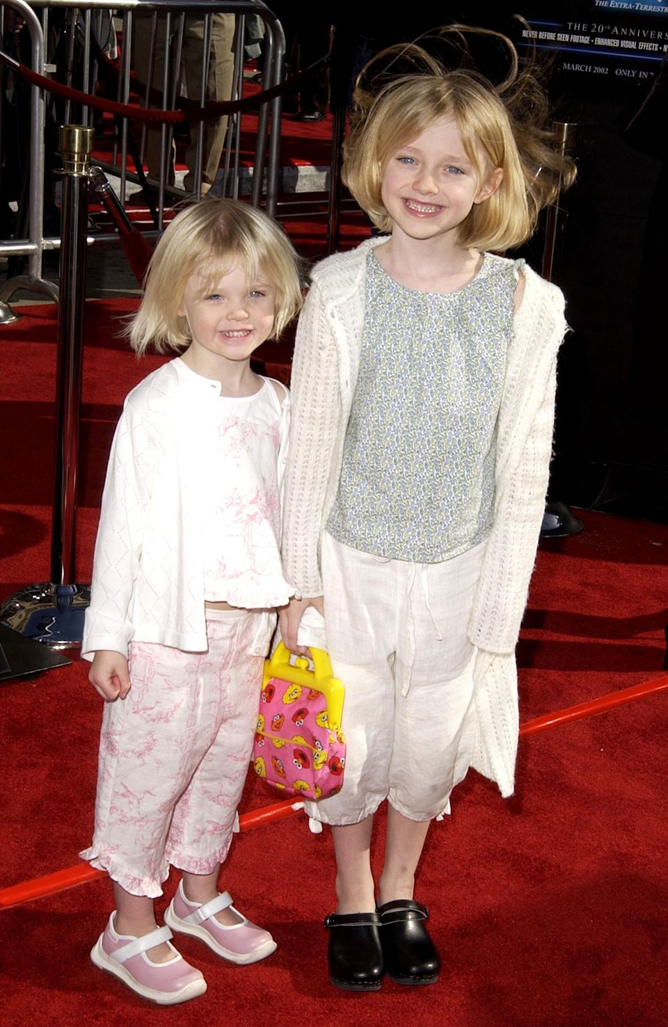 "The Fanning sisters (Elle to the left, Dakota to the right) at the 20th anniversary premiere of Steven Spielberg's ""E.T."" at the The Shrine Auditorium in Los Angeles."