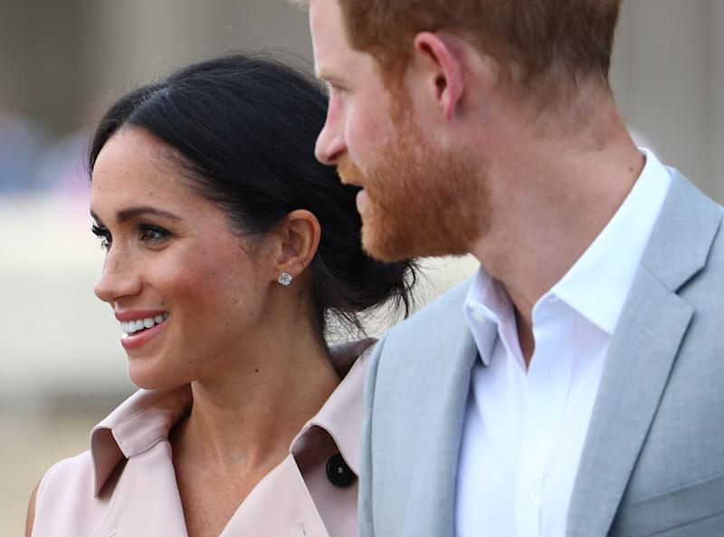 Meghan Markle and Prince Harry, the Duke and Duchess of Sussex, arriving at the Nelson Mandela Centenary Exhibition on Tuesday.  (Hannah Mckay / Reuters)