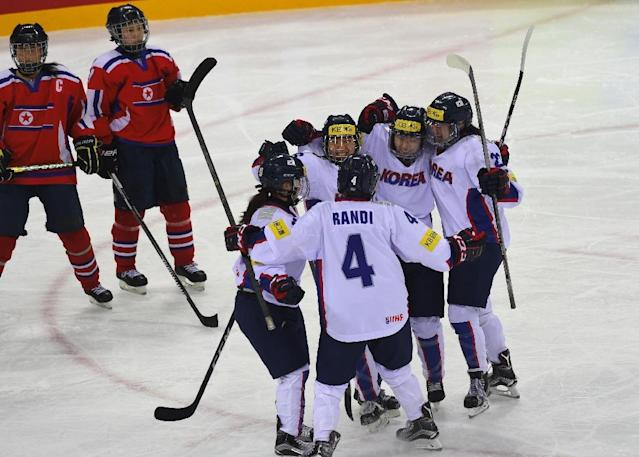 South Korea (white) celebrates after scoring against North Korea during their IIHF women's world ice hockey championships match in Gangneung on April 6, 2017 (AFP Photo/JUNG Yeon-Je)