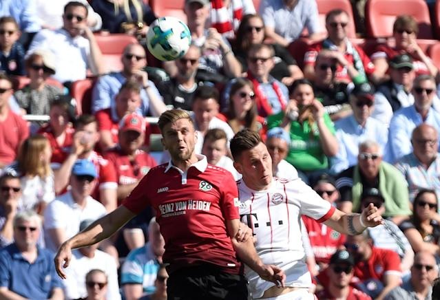 Soccer Football - Bundesliga - Hannover 96 vs Bayern Munich - HDI-Arena, Hanover, Germany - April 21, 2018 Hannover's Niclas Fullkrug in action with Bayern Munich's Niklas Sule REUTERS/Fabian Bimmer DFL RULES TO LIMIT THE ONLINE USAGE DURING MATCH TIME TO 15 PICTURES PER GAME. IMAGE SEQUENCES TO SIMULATE VIDEO IS NOT ALLOWED AT ANY TIME. FOR FURTHER QUERIES PLEASE CONTACT DFL DIRECTLY AT + 49 69 650050