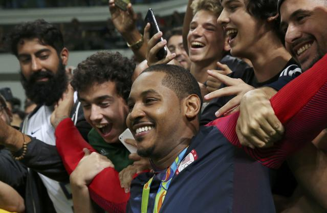 Carmelo Anthony and Team USA celebrate winning gold. (REUTERS)