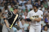 Milwaukee Brewers' Willy Adames, right, tosses his bat after drawing an RBI-walk during the fourth inning of a baseball game against the Chicago White Sox, Saturday, July 24, 2021, in Milwaukee. (AP Photo/Aaron Gash)