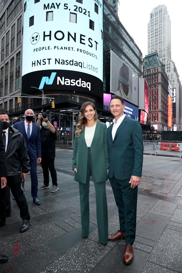 NEW YORK, NEW YORK - MAY 05: The Honest Company founder and chief creative officer Jessica Alba and The Honest Company CEO Nick Vlahos pose outside of Nasdaq as The Honest Company rings the Nasdaq Stock Market opening bell to mark the company's IPO at NASDAQ MarketSite on May 05, 2021 in New York City. (Photo by Dimitrios Kambouris/Getty Images for The Honest Company )