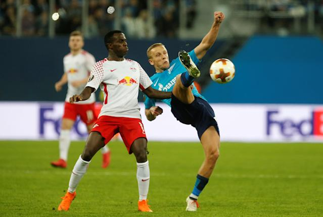 Soccer Football - Europa League Round of 16 Second Leg - Zenit Saint Petersburg vs RB Leipzig - Stadium St. Petersburg, Saint Petersburg, Russia - March 15, 2018 Zenit St. Petersburg's Igor Smolnikov in action with RB Leipzig's Bruma REUTERS/Anton Vaganov