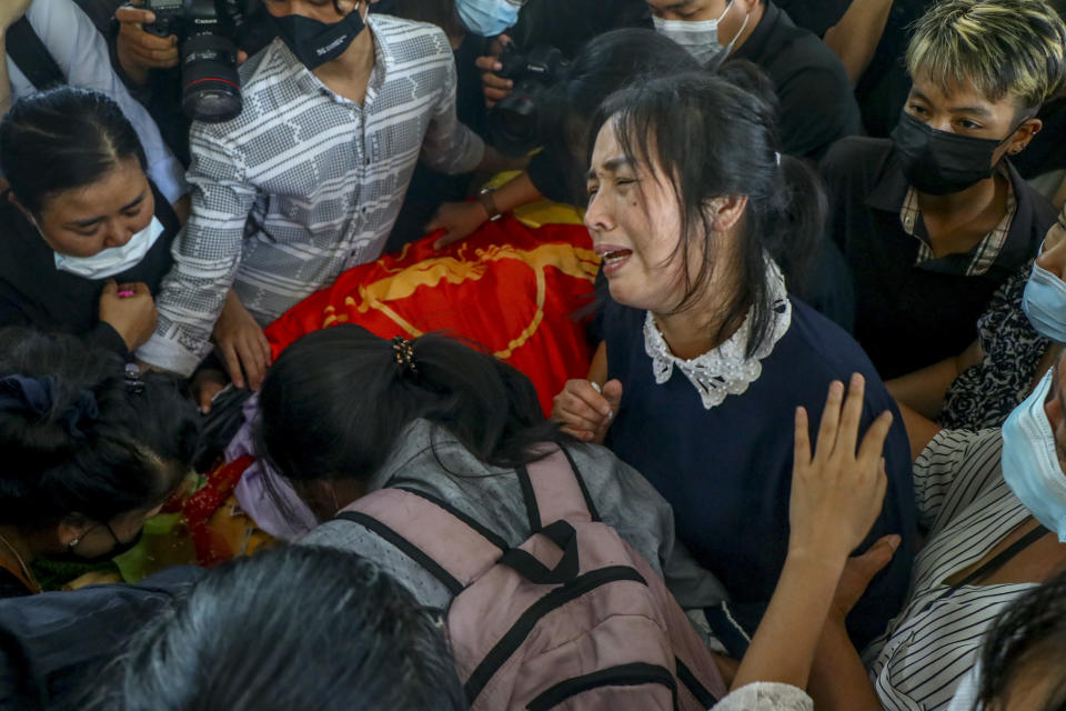 The mother of Khant Ngar Hein weeps during his funeral in Yangon, Myanmar Tuesday, March 16, 2021. Khant Ngar Hein, an 18-year old medical student, was fatally shot by security forces during an anti-crop protest on Sunday, March 14, in Tamwe, Yangon. Demonstrators in several areas of Myanmar protesting last month's seizure of power by the military held small, peaceful marches before dawn Tuesday, avoiding confrontations with security forces who have fatally shot scores of their countrymen in the past few days. (AP Photo)