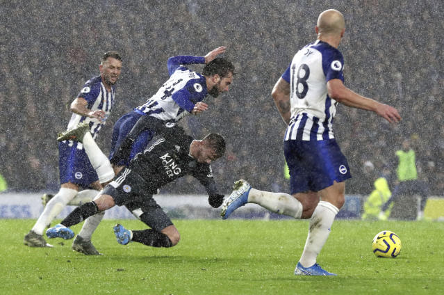 Leicester City's James Maddison and Brighton and Hove Albion's Davy Propper suffer a clash, during the English Premier League soccer match between Brighton and Hove and Leicester City, at the AMEX Stadium, in Brighton, England, Saturday, Nov. 23, 2019. (Gareth Fuller/PA via AP)