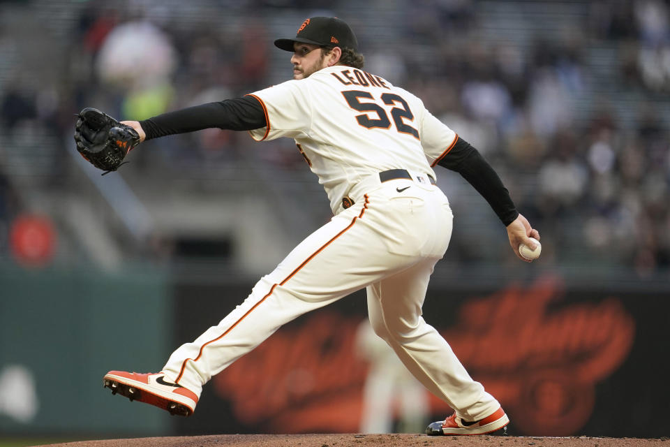 San Francisco Giants' Dominic Leone pitches against the San Diego Padres during the first inning of a baseball game in San Francisco, Wednesday, Sept. 15, 2021. (AP Photo/Jeff Chiu)