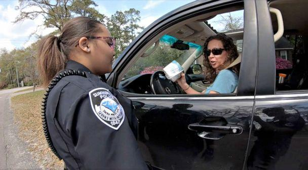 PHOTO: Summerville, S.C. police officers handed out toilet paper to drivers. (Summerville, S.C. Police Dept)