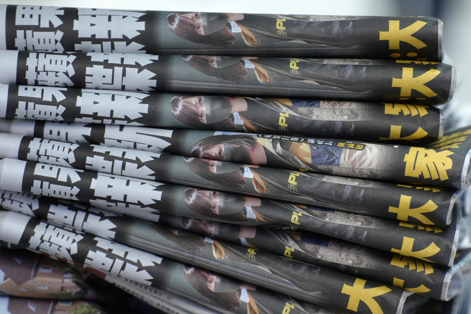 Copies of Apple Daily are seen at a newspaper stand at a downtown street in Hong Kong Friday, June 18, 2021. The pro-democracy paper increased its print run to 500,000 copies on Friday, a day after police arrested five top editors and executives and froze $2.3 million in assets linked to the media company. (AP Photo/Vincent Yu)