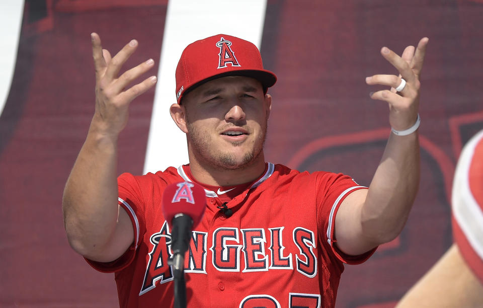 Los Angeles Angels center fielder Mike Trout gestures during a news conference to talk about Trout's 12-year, $426.5 million contract, prior to the team's exhibition baseball game against the Los Angeles Dodgers on Sunday, March 24, 2019, in Anaheim, Calif. (AP Photo/Mark J. Terrill)