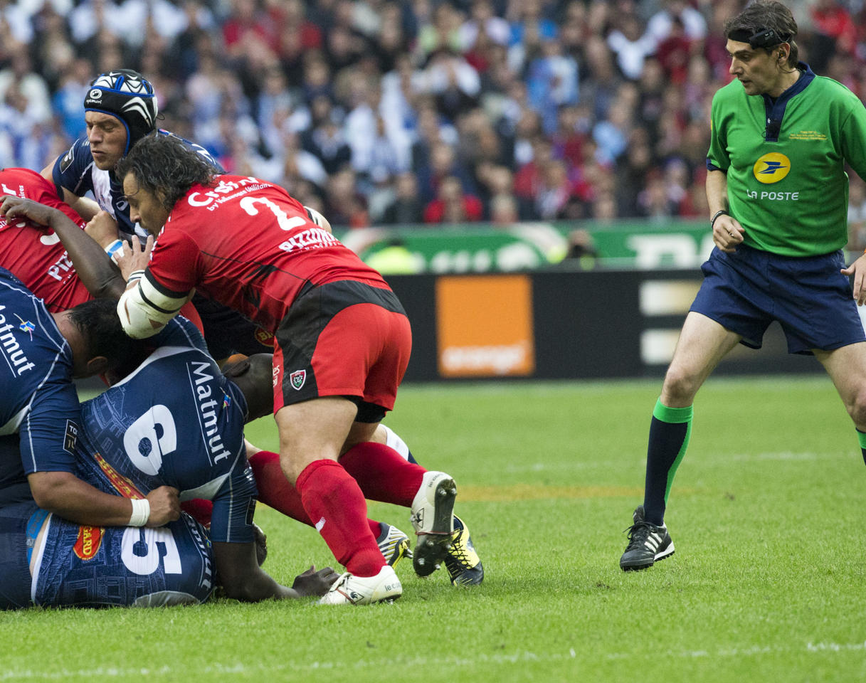 Referee Jerome Garcies, right, controls rubgy pack with camera control attached to the head during their Top 14 final rugby match between Toulon and Castres at Stade de France stadium in Saint Denis, north of Paris, France, Saturday, June 1, 2013. (AP Photo/Jacques Brinon)