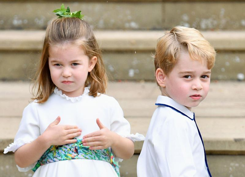 WINDSOR, UNITED KINGDOM - OCTOBER 12: (EMBARGOED FOR PUBLICATION IN UK NEWSPAPERS UNTIL 24 HOURS AFTER CREATE DATE AND TIME) Princess Charlotte of Cambridge and Prince George of Cambridge attend the wedding of Princess Eugenie of York and Jack Brooksbank at St George's Chapel on October 12, 2018 in Windsor, England. (Photo by Pool/Max Mumby/Getty Images)