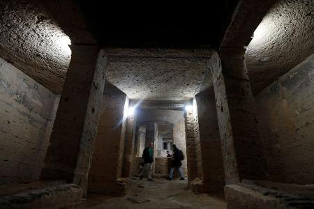 People take part in a tour by officials of the Ministry of Antiquities of the Kom El-Shoukafa catacombs in Alexandria, Egypt March 3, 2019. REUTERS/Amr Abdallah Dalsh