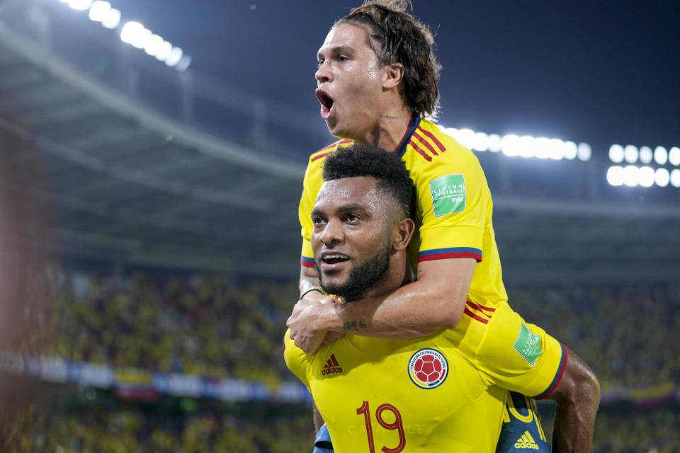 Colombia's Miguel Borja (19) celebrates with teammate Juan Quinteroo after scoring his side's second goal against Chile during a qualifying soccer match for the FIFA World Cup Qatar 2022 in Barranquilla, Colombia, Thursday, Sept. 9, 2021. (AP Photo/Fernando Vergara)
