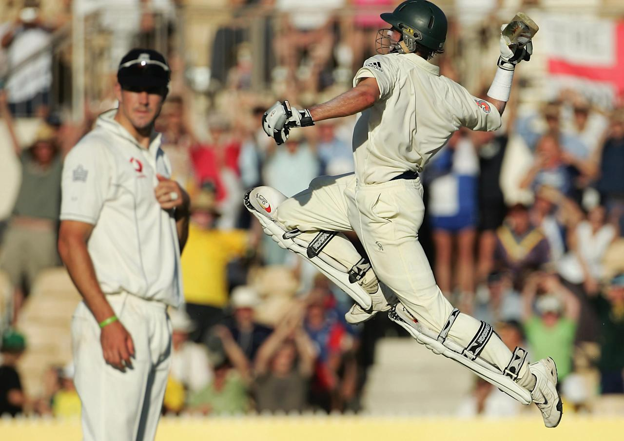 ADELAIDE, AUSTRALIA - DECEMBER 05:   Mike Hussey of Australia jumps in celebration past Kevin Pietersen of England on day five of the second Ashes Test Match between Australia and England at the Adelaide Oval on December 5, 2006 in Adelaide, Australia.     (Photo by James Knowler/Getty Images)