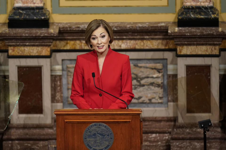 FILE - In this Jan. 12, 2021 file photo, Iowa Gov. Kim Reynolds delivers her Condition of the State address before a joint session of the Iowa Legislature at the Statehouse in Des Moines, Iowa. As Republicans march ahead with their campaign to tighten voting laws in political battlegrounds, some in their party are worried the restrictions will backfire by making it harder for GOP voters to cast ballots. The restrictions backed by Republicans in Iowa, Georgia, Florida, Texas and Arizona often take aim at mail voting, a method embraced by voters from both parties but particularly popular with older voters. (AP Photo/Charlie Neibergall, File)