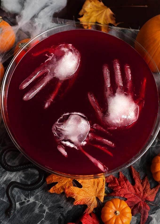 """<p>Planning on hosting a Halloween party this season? There's nothing quite like inviting your ghoul-friends over for a spooky evening full of watching <a href=""""https://www.thepioneerwoman.com/news-entertainment/g32578311/scary-halloween-movies/"""" rel=""""nofollow noopener"""" target=""""_blank"""" data-ylk=""""slk:scary Halloween movies"""" class=""""link rapid-noclick-resp"""">scary Halloween movies</a>, playing Halloween games and munching on <a href=""""https://www.thepioneerwoman.com/food-cooking/meals-menus/g32110899/best-halloween-desserts/"""" rel=""""nofollow noopener"""" target=""""_blank"""" data-ylk=""""slk:Halloween desserts."""" class=""""link rapid-noclick-resp"""">Halloween desserts.</a> After finalizing your <a href=""""https://www.thepioneerwoman.com/holidays-celebrations/g32333455/halloween-party-themes/"""" rel=""""nofollow noopener"""" target=""""_blank"""" data-ylk=""""slk:Halloween party theme"""" class=""""link rapid-noclick-resp"""">Halloween party theme</a> and putting the finishing touches on your <a href=""""https://www.thepioneerwoman.com/holidays-celebrations/g36720629/walmart-halloween-decorations/"""" rel=""""nofollow noopener"""" target=""""_blank"""" data-ylk=""""slk:Halloween decorations"""" class=""""link rapid-noclick-resp"""">Halloween decorations</a>, it's time to start thinking about the best treat for the adults at your bash: Drinks! When to comes to parties, punch drinks are perfect—because who wants the fuss of constantly refilling glasses?</p><p>Ahead you'll find the best Halloween punch recipes to spook-ify your October gathering. There's truly something here for every party—from a tasteful blood orange champagne punch to a creative Jell-O toxic ooze recipe. Pumpkin fanatics like Ree Drummond might opt for the sparkling pumpkin spice punch, while wine lovers will be set with the assortment of festive sangria and mulled wine beverages listed here. The best part of punch recipes (besides how delicious and easy they are!) is that you can add as much or as little booze as you'd like. In fact, some of these drinks are alcohol-free. </p><p>"""