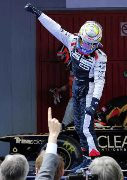 Williams driver Pastor Maldonado, from Venezuela celebrates his victory after the Spanish Grand Prix at Catalunya racetrack in Montmelo, near Barcelona, Spain, Sunday, May 13, 2012. Maldonado become the sport's first Venezuelan winner, while Williams' 114th triumph was its first since the 2004 Brazilian GP. (AP Photo/Manu Fernandez)